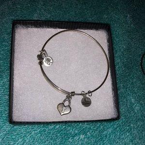 Heart and key Alex and Ani bracelet.